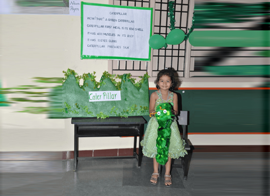 Charming girl with her green caterpilar.