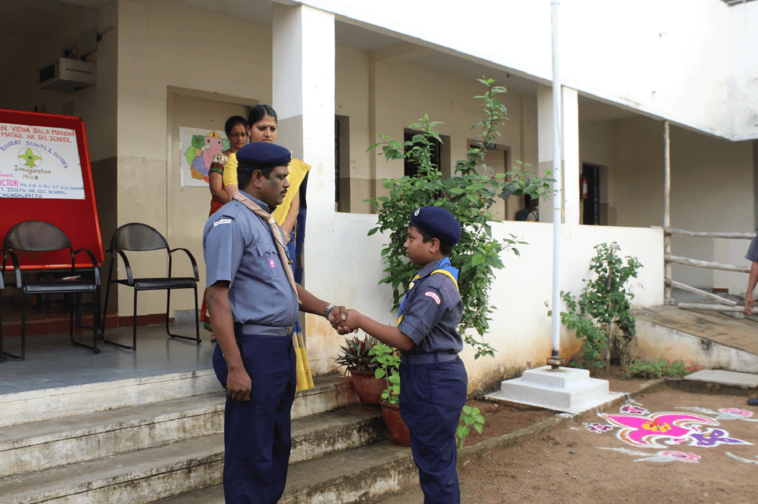 The left-handed handshake unites two scouts from anywhere on the planet