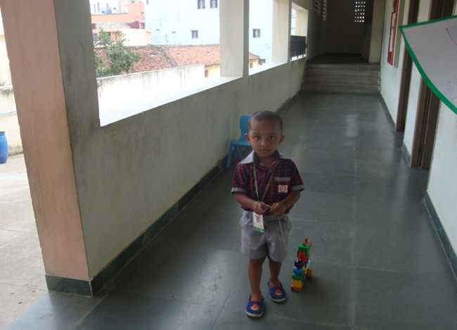 A little one pulling the train in the corridor