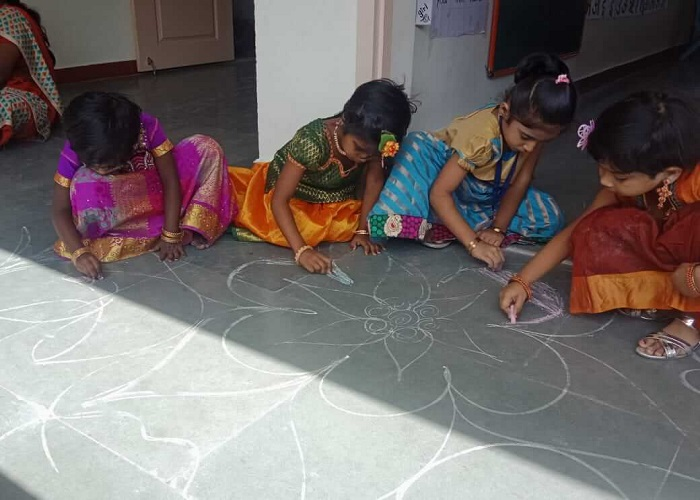 We colour and make our rangoli look lively...