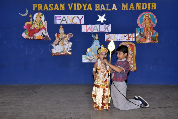 Kids dressed up in costumes of Lord Muruga showcasing their religion