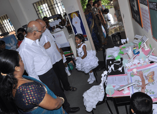 The Child explaining to the dignatories the different types of paper.